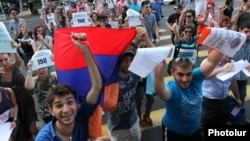 Armenia - Youth activists celebrate Yerevan Mayor Taron Markarian's decision to reverse a rise in transport fares, 25Jul2013.