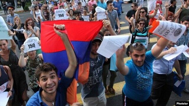 Armenia - Youth activists celebrate Yerevan Mayor Taron Markarian's decision to reverse a rise in transport fares, 25Jul2013.