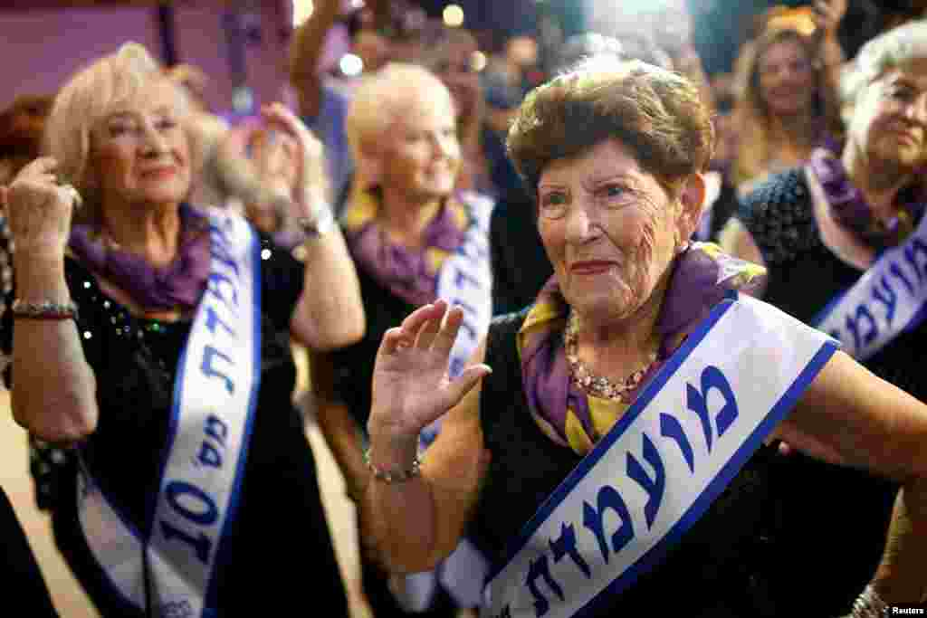 Holocaust survivor Carmela Ben Yehuda, 89, dances during the annual Holocaust survivors' beauty pageant in the Israeli city of Haifa. (Reuters/Amir Cohen)
