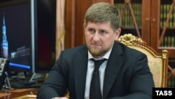 Russia -- The head of Chechnya's regional government, Ramzan Kadyrov, looks on during a meeting with the Russian presiden