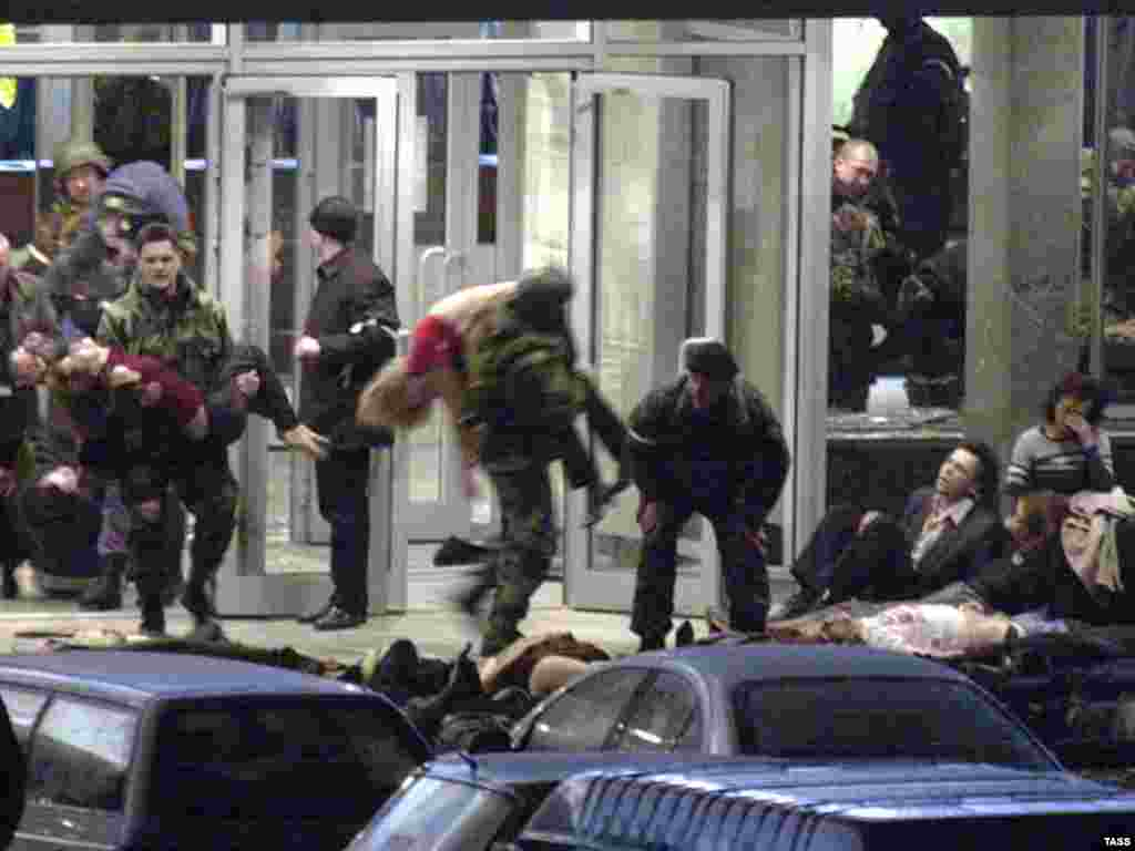 Troops carry out hostages, many of whom were badly affected by the gas pumped into the theater to subdue the militants.