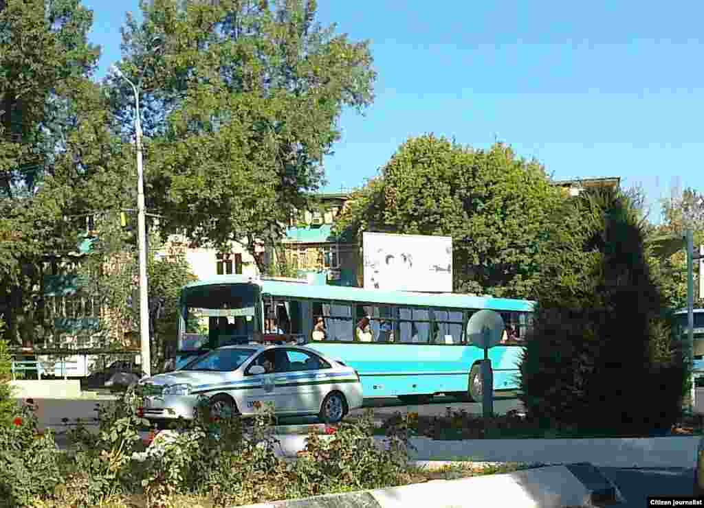 Some buses, like this one in the Sirdarya region, receive a police escort.