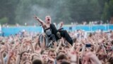 Belarus -- Pavel Konovalchik dances in his wheelchair as he is held above the crowd during the Rock Za Bobrov festival near Minsk. July 22, 2017.