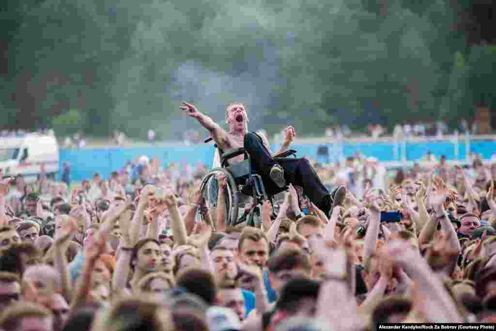 It's safe to assume disabled rock fan Paval Konovalchik recalled this moment as a positive: The music aficionado was hoisted above the throng by a group of strangers during a set of one of his favorite bands near Minsk.