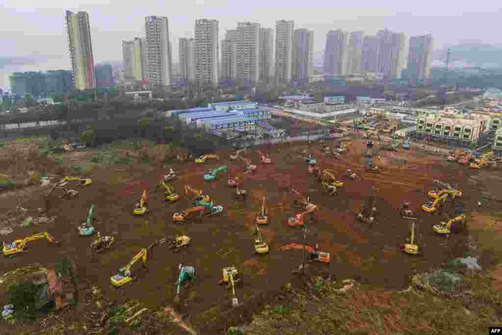 Excavators at the construction site of a new hospital being built to treat patients from the deadly outbreak of the coronavirus in Wuhan in China's central Hubei Province. China is rushing to build a new hospital in a staggering 10 days to treat patients at the epicenter of the outbreak that has killed at least 56 and infected almost 2,000 others. (AFP/Stringer)