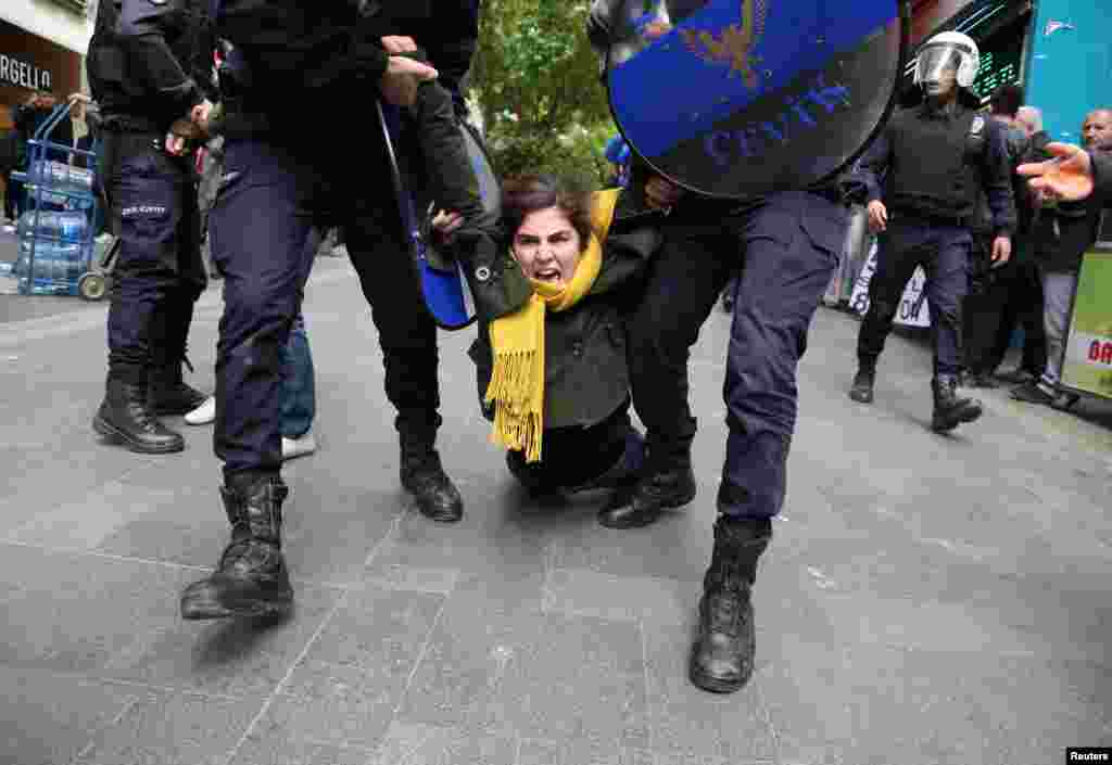 Riot police detain a demonstrator during a protest against the detention of two hunger-striking teachers in Ankara, Turkey. (Reuters)