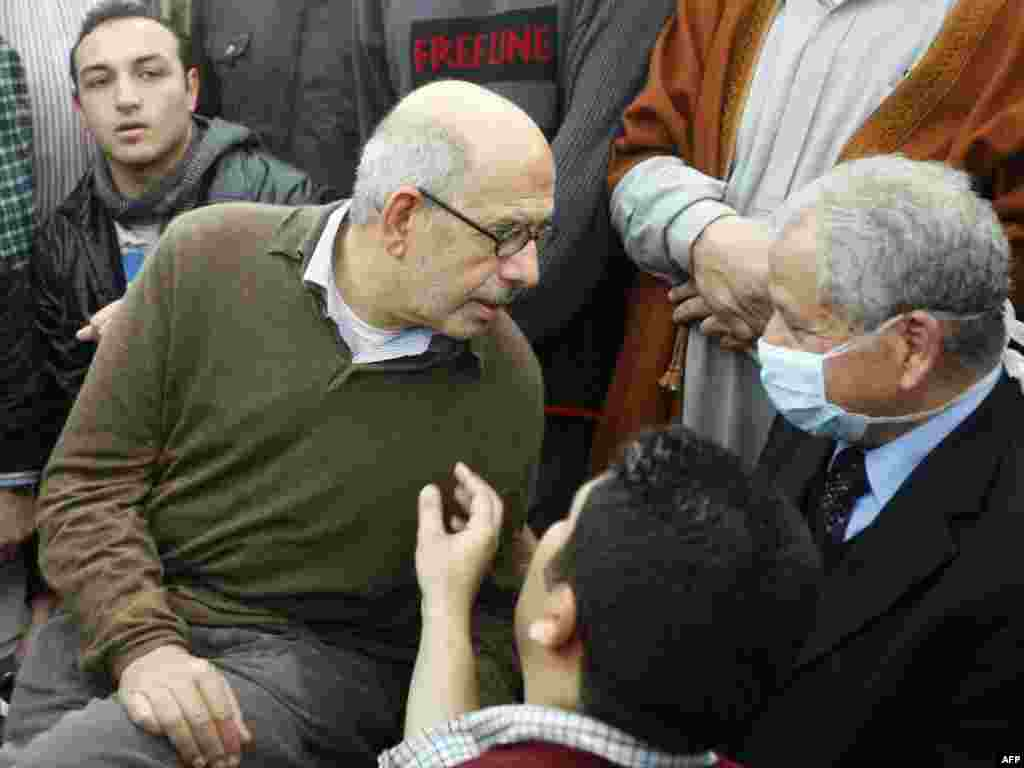 Muhammad El-Baradei in a mosque after riot police used water cannons to disperse demonstrators on January 28.