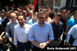 VMRO-DPMNE leader Hristijan Mickoski (center) at a protest against the deal between Greece and Macedonia in the southern town of Bitola in June