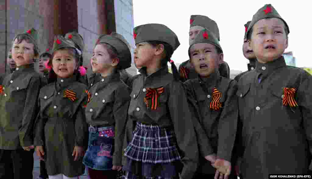 Kyrgyz children sing during meetings with World War II veterans on Victory Square in Bishkek. The region is marking the 74th anniversary of the victory over Nazi Germany. The Soviet Union lost 27 million people in the war. (epa-EFE/Igor Kovalenko)