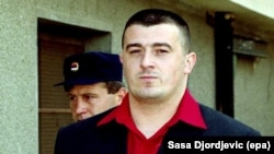 Sasa Cvjetan arrives at the Court of Justice in the Serbian town of Prokuplje on October 9, 2002.