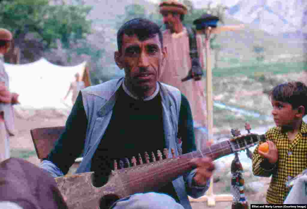 A rabab player who accompanied the family on the trip into Nuristan. The rabab is one of Afghanistan's national instruments.