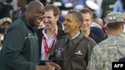 Ex-NBA great Magic Johnson (left) with U.S. President Barack Obama in November 2011