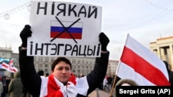 "A protester holds a banner reading ""No to integration!"" during a rally in downtown Minsk on December 7."