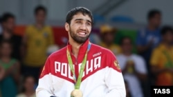 Judoka Khasan Khalmurzaev of Russia poses with his gold medal at a victory ceremony for the men's 81-kilogram judo event at the Rio 2016 Summer Olympic Games at Carioca Arena, Rio de Janeiro, on August 9.
