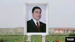 A photo of Turkmen President Gurbanguly Berdymukhammedov watches over the races at Ashgabat's presidential race track