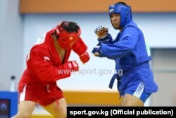 Athletes compete in the sambo combat event at the Asian Indoor Games.