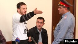 Tigran Arakelian gestures during his trial at the Court of Appeal in Yerevan on October 9.