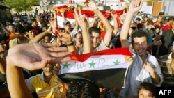 Iraqis celebrate the victory of their country's soccer team at the final of the Asian Football Cup 2007