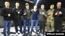 American Robert Rundo (C), leader of the California-based violent alt-right group known as the Rise Above Movement (RAM), with Ukrainian Azov members at Reconquista Club in Kyiv on 27 April 2018 as shown on Reconquista's Facebook page.