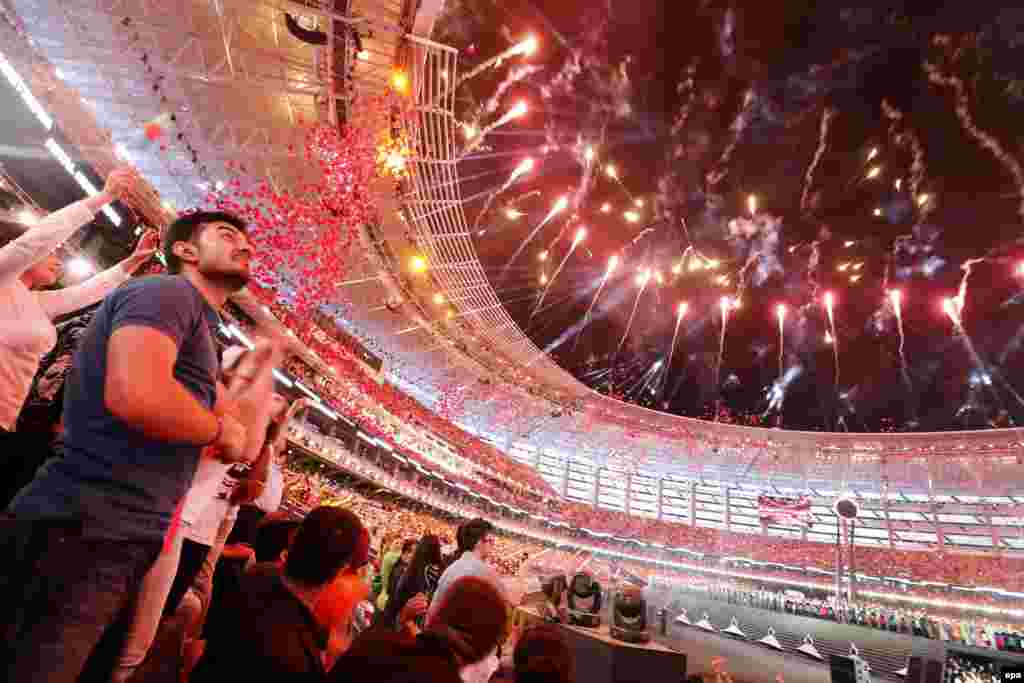 Fireworks explode during the opening ceremony of the 2015 European Games at Baku Olympic Stadium.