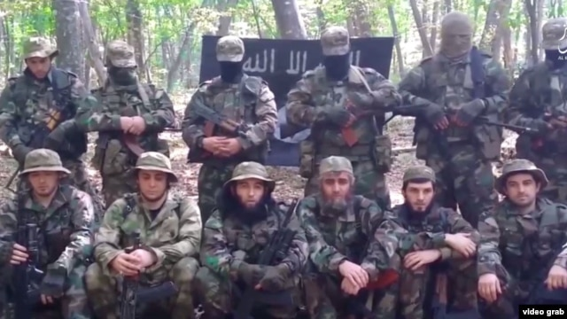 """A screen grab from a video message released by Furat Media, Islamic State's Russian-language media wing, urging would-be militants in Russia to """"go out and wage jihad in the Caucasus."""""""