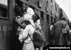 Refugees board a double-decker train carriage to escape the fighting in 1919. Most of the millions of casualties of the war were civilians.