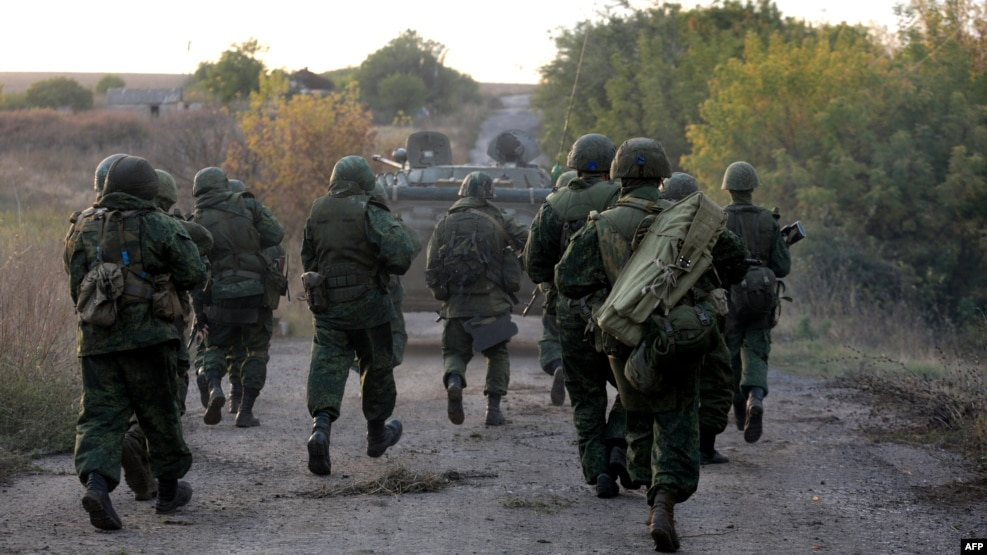 Pro-Russia separatist fighters on the move near Donetsk (file photo)