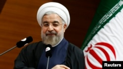 Iranian President Hassan Rohani addresses the audience during a meeting in Ankara on June 10.