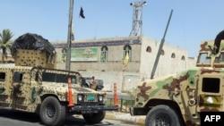 Біля пошкодженої вибухом шиїтської мечеті в Багдаді, 18 червня 2013 року