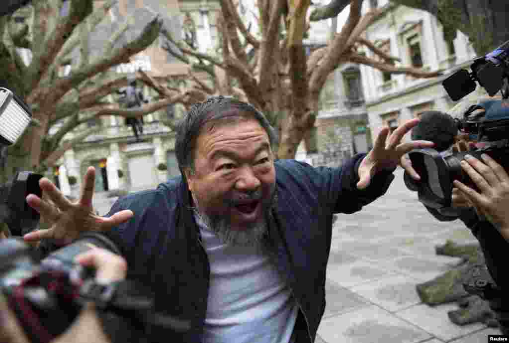 Chinese artist Ai Weiwei poses for photographers during a photocall for his exhibition at the Royal Academy of Arts in London. (Reuters/Neil Hall)