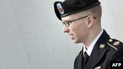 Pfc. Bradley Manning is escorted following a motions hearing in the case US vs. Manning at Fort Meade in Maryland in March.