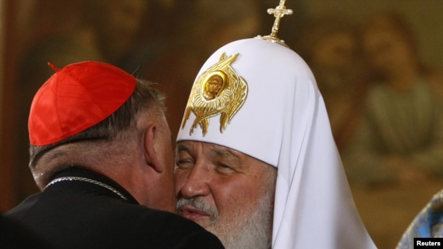 Kirill, the patriarch of Moscow and All Russia, greets Cardinal Kazimierz Nycz (left), the archbishop of Warsaw.