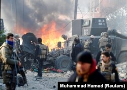 Iraqi Special Operations Forces react after a car bomb exploded during an operation to clear the al-Andalus district of Mosul of Islamic State militants on January 16.