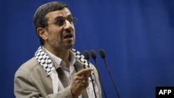 Mahmud Ahmadinejad delivers a speech at the podium of the Friday Prayer in Tehran University during the Quds Day rally on August 17.