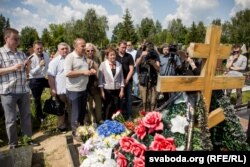 People gather at the gravesite of journalist Pavel Sheremet in Minsk on July 20.