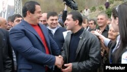 Armenia - Prosperous Armenia Party leader Gagik Tsarukian (L) campaigns in Dilijan, 17Apr2012.