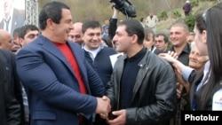 Armenia - Prosperous Armenia Party leader Gagik Tsarukian (L) campaigns in Dilijan, 17Apr2012.