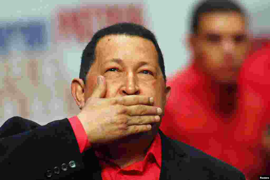 Venezuelan President Hugo Chavez blows a kiss as he arrives at a rally with supporters in Caracas in February 2012, before flying to Cuba for a new round of cancer surgery.
