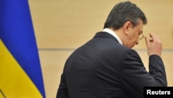 Ousted Ukrainian President Viktor Yanukovych leaves his press conference in Rostov-on-Don, Russia, on March 11.