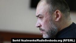 Юрій Крисін під час суду, на якому його звинувачують у координації вбивства журналіста і нападів на майданівців