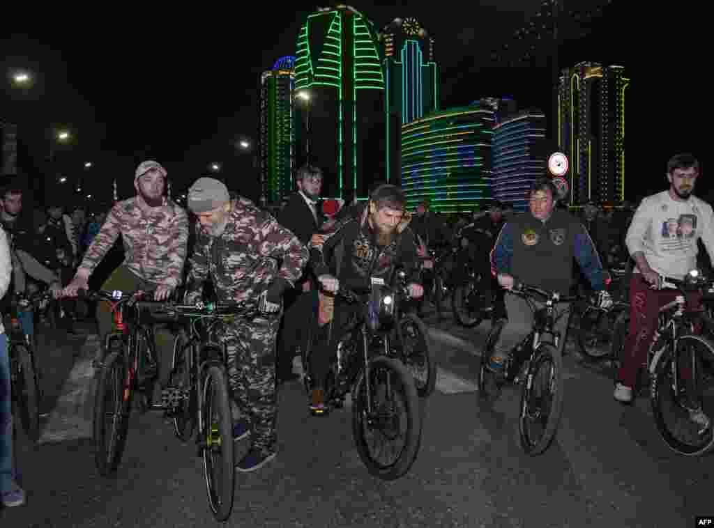 Chechen leader Ramzan Kadyrov (center) rides a bicycle during the opening of cycling season in Grozny on May 8. (AFP/Elena Fitkulina)
