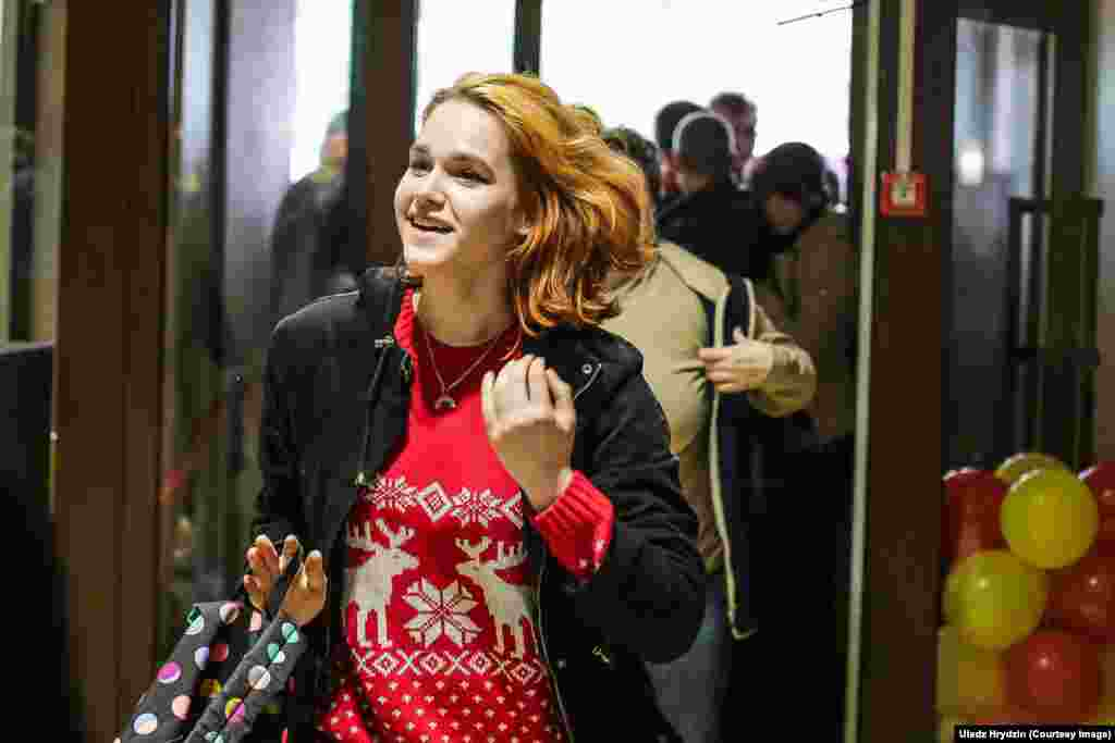 This young woman looks happy to have made it through the crush, but Belarus may be worried about the popularity of fast food outlets like this one. Obesity rates among females in the country are the highest in Europe.