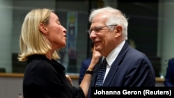 European Union foreign policy chief Federica Mogherini (left) and Spanish Foreign Minister Josep Borrell at the EU foreign ministers' meeting in Brussels on July 15.