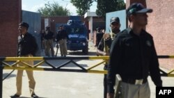 A Pakistani anti-terrorism court official arrives in an armored vehicle at Adyala Prison in Rawalpindi
