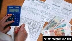 Оплата услуг ЖКХ (иллюстративное фото)