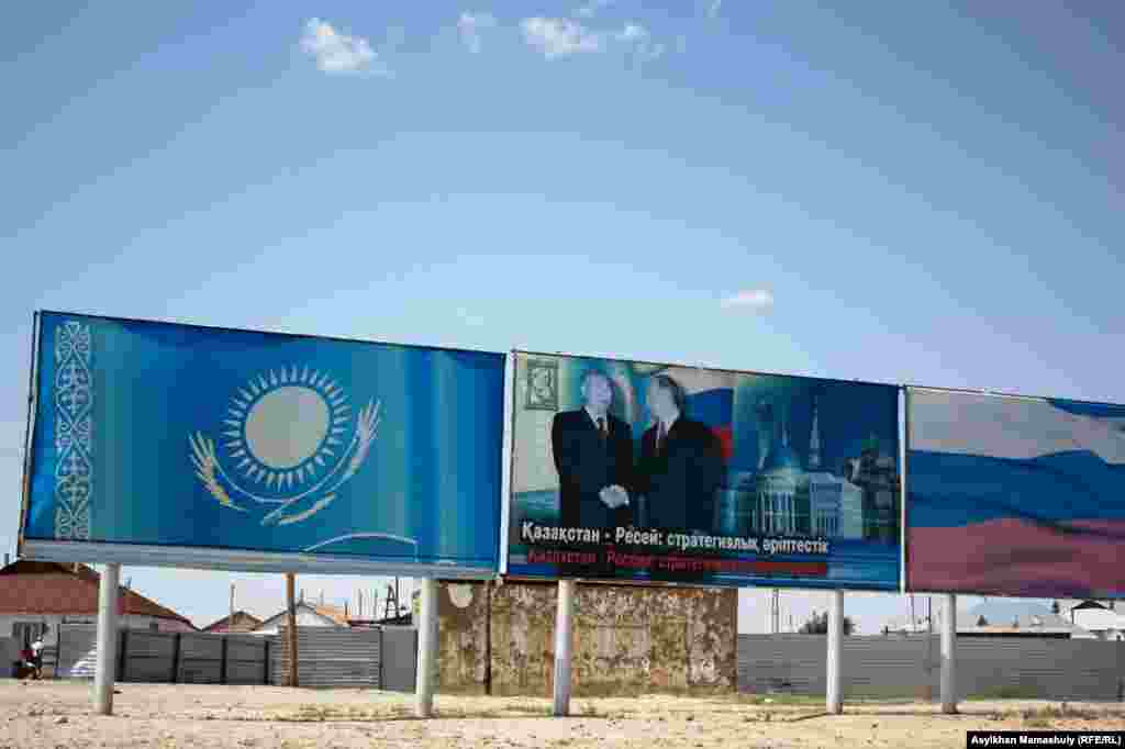 "A billboard in Toretam showing the Kazakh and Russian presidents shaking hands reads: ""Strategic Partnership."""