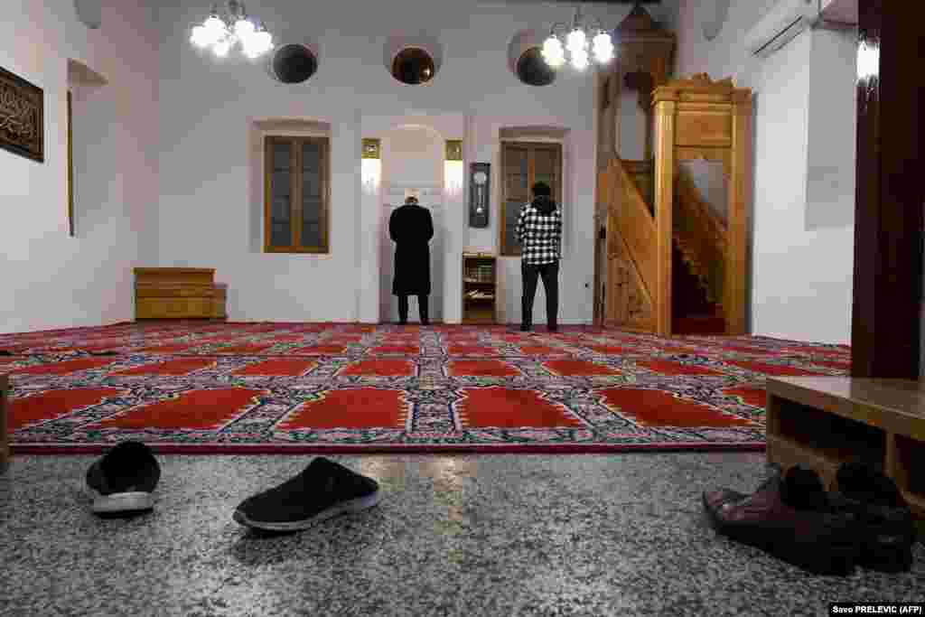 An imam and a worshipper pray alone in a mosque in Podgorica, Montenegro, on April 23. The first night of the holy month of Ramadan came amid a government-imposed nationwide lockdown to prevent the spread of the coronavirus.