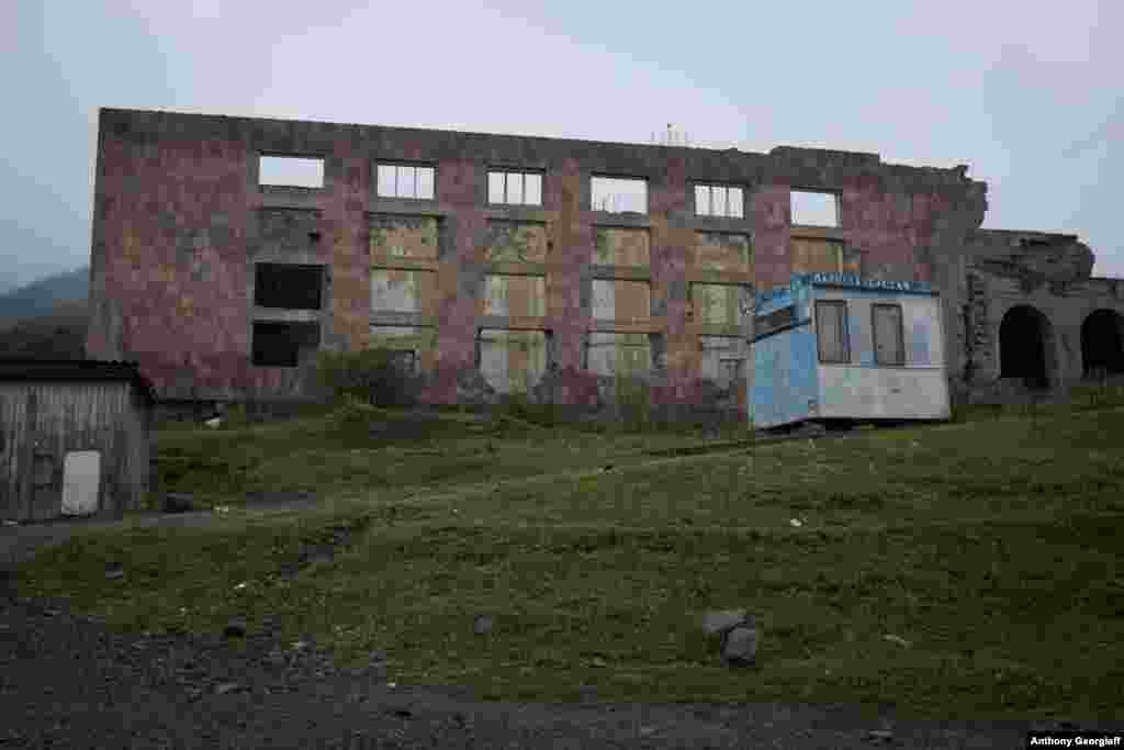 A derelict building in this poor region of Armenia contrasts with the brightly colored homes of the Molokans nearby.