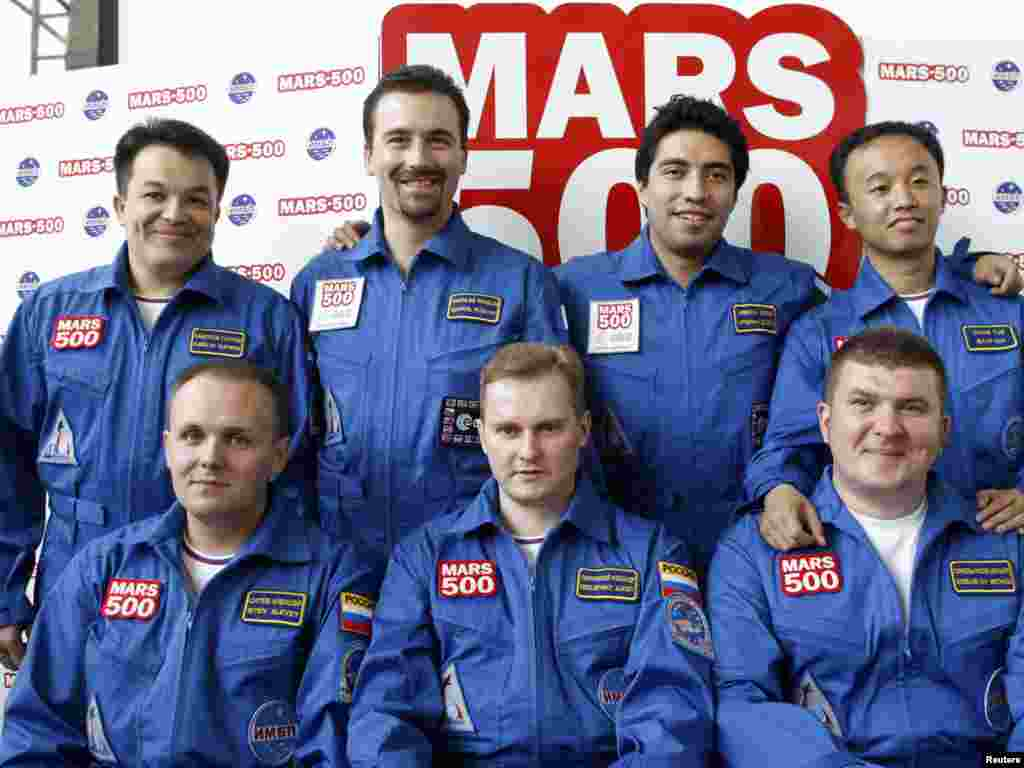 The seven volunteers for the Mars-500 experiment, only six of which actually entered the simulator: Aleksei Sitev, Aleksandr Smoleyevsky, and backup Mikhail Sinelnikov (left to right, front row) and Sukhrob Kamolov, Romain Charles, Diego Urbina, and Wang Yue (left to right back row)