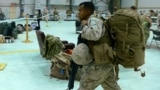 Afghanistan -- A US Marine carries his equipment as US troops arrive in Kandahar after their withdrawl from the Camp Bastion-Leatherneck complex in Helmand province on October 26, 2014.
